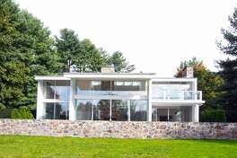 This 3,943-square-foot house invites indoor-outdoor living with walls of glass and doors to the sizable bluestone terraced patio.