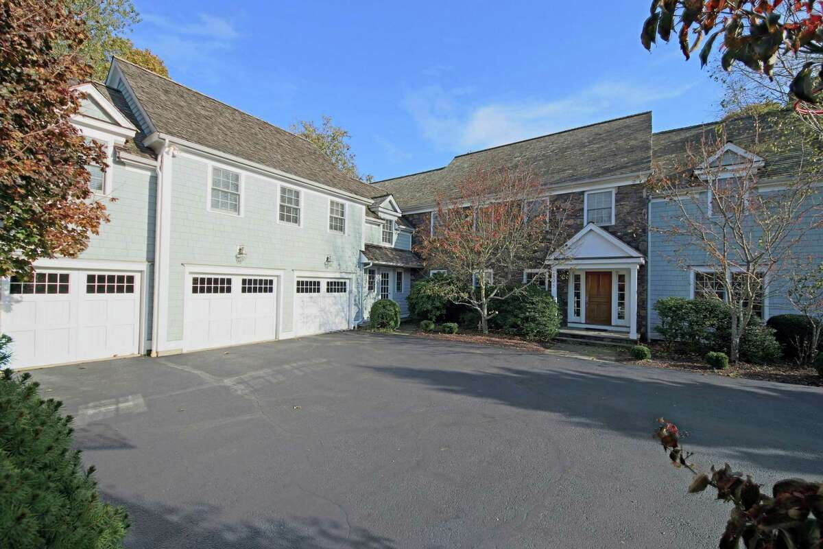 The gray wood and stone colonial house at 805 Cedar Road features 6,900 square feet of living space and surprise features.