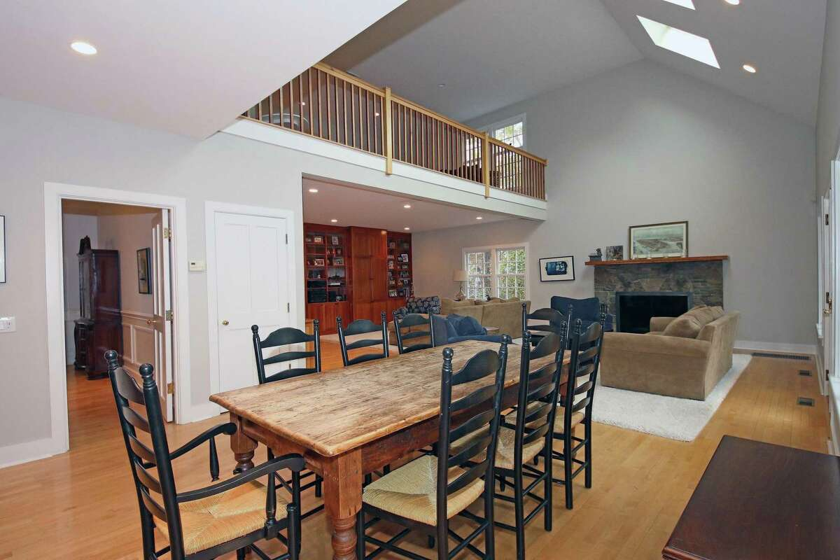 The eat-in area of the gourmet kitchen is open to the spacious family room, which features a stone fireplace and French doors to the patio.