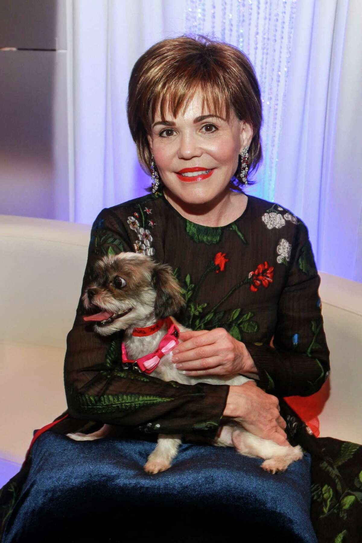 """Hallie Vanderhider with """"Ling Ling,"""" a shelter dog available for adoption, at The Citizens for Animal Protection Gala."""