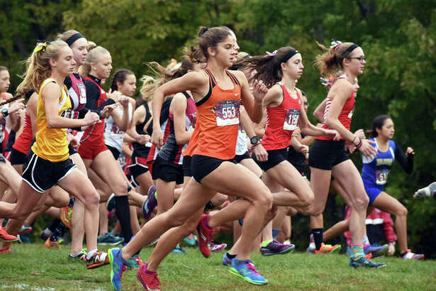 Edwardsville's Abby Korak runs away from the field at the start of the Class 3A Quincy Sectional at Bob Mays Park.