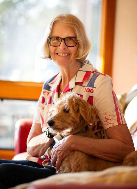 Pulitzer Prize winning novelist Jane Smiley poses with her dog, Abby, at her sunny hillside home above Carmel Valley. Photo: Patrick Tehan / Special To The Chronicle