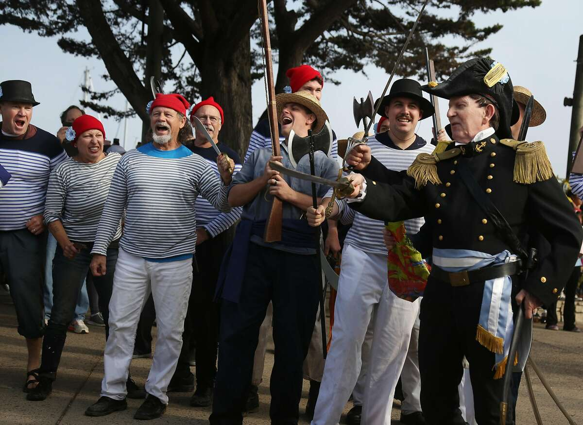 Reenactors portraying Argentine privateers/pirates prepare to pull down the Spanish flag and raise the Argentinian flag above Monterey as Spanish troops retreat during the bicentennial reenactment of the Battle of Monterey on Saturday, 11/17, 2018 in Monterey, California.