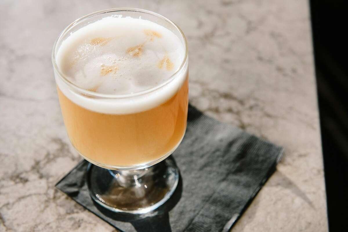 The Last Airbender cocktail, barsol pisco quebranta, el silencio mezcal, hitching white ale, apricot, lemon, amargo chucho, and egg whites, at Kaiyo restaurant in San Francisco, California, on Wednesday, November 14, 2018.
