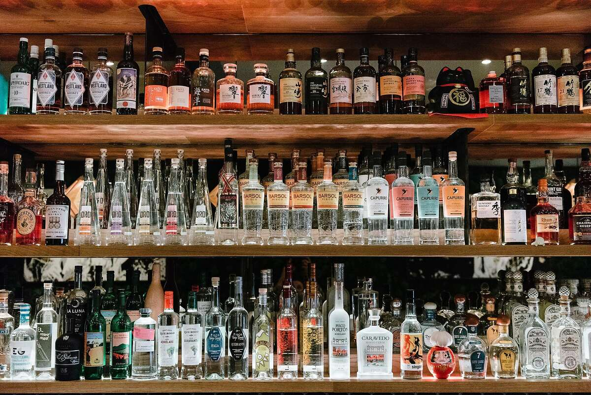 Bottles of pisco, a Peruvian brandy, are displayed behind the bar at Kaiyo restaurant in San Francisco, California, on Wednesday, November 14, 2018.