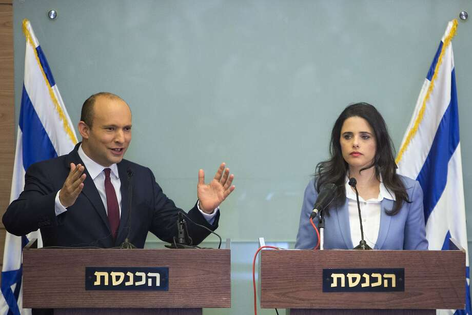 Education Minister Naftali Bennett (left) and Justice Minister Ayelet Shaked back the coalition. Photo: Sebastian Scheiner / Associated Press