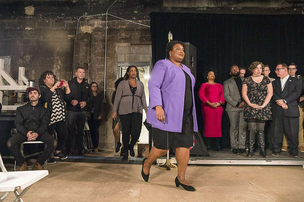 Georgia Gubernatorial Democratic candidate Stacey Abrams enters a room prepared to end her campaign during a press conference at the Abrams Headquarters in Atlanta, Friday, Nov. 16, 2018. Abrams ended her challenge to Republican Brian Kemp in the Georgia governor's race on Friday, but pledged to fight the former secretary of state's