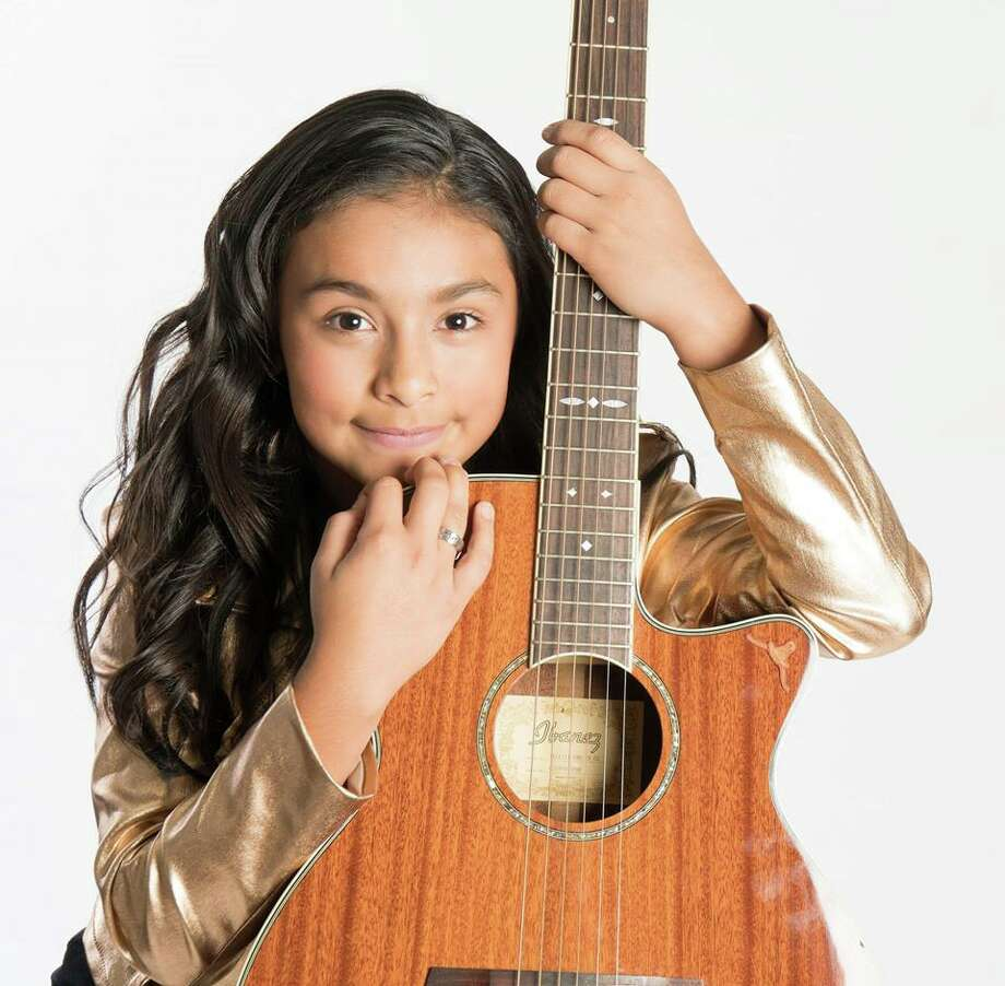 "PHOTOS: Tejano legend Selena Quintanilla Mia Garcia, an 11-year-old Tejano singer based in Austin, recently became the youngest artist to be nominated for and win ""Best New Female Artist"" at the Tejano Music Awards, according to her Facebook page. 