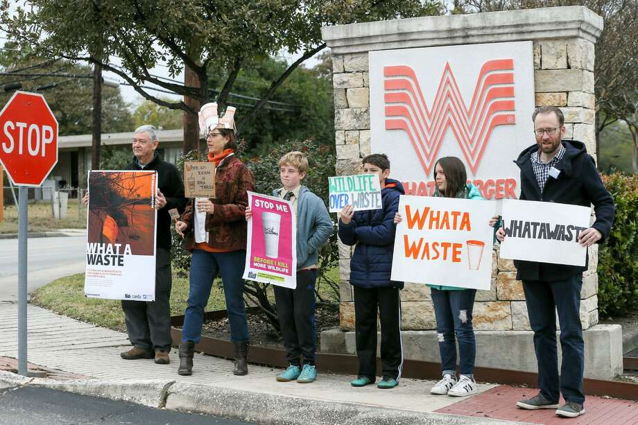 Alan Montemayor, from left; Carye Bye; Gustavo Metzger, 12; Emmanuel Perez, 12; Isabel Perez, 12; and Luke Metzger hold signs Monday outside Whataburger's San Antonio headquarters at 300 Concord Plaza. The group then delivered a petition signed by more than 50,000 people that originated with environmental groups Environment Texas, Surfrider Foundation's Texas Coastal Bend Chapter and Care2.com. The petition asks Whataburger to stop its use of polystyrene foam (commonly known as Styrofoam) cups and containers at its restaurants. Photo: Marvin Pfeiffer /Staff Photographer / Express-News 2018
