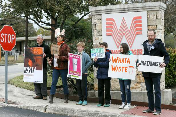 Alan Montemayor, from left; Carye Bye; Gustavo Metzger, 12; Emmanuel Perez, 12; Isabel Perez, 12; and Luke Metzger hold signs Monday outside Whataburger's San Antonio headquarters at 300 Concord Plaza. The group then delivered a petition signed by more than 50,000 people that originated with environmental groups Environment Texas, Surfrider Foundation's Texas Coastal Bend Chapter and Care2.com. The petition asks Whataburger to stop its use of polystyrene foam (commonly known as Styrofoam) cups and containers at its restaurants.