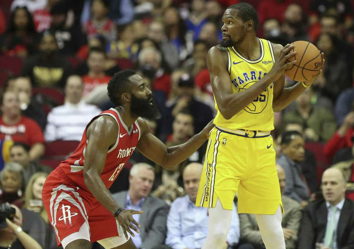 Houston Rockets guard James Harden (13) defensing Golden State Warriors forward Kevin Durant (35) during the first quarter of the NBA game at Toyota Center on Thursday, Nov. 15, 2018, in Houston.