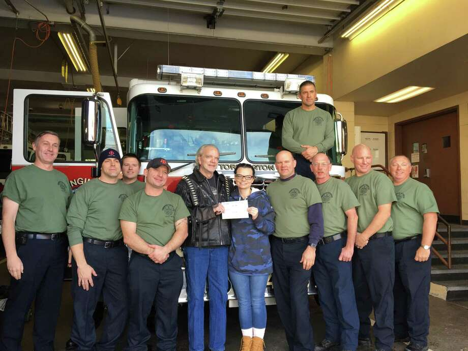 The Torrington Fire Department received a $2,000 donation for its annual Christmas for Children toy drive from Litchfield resident Gary James on Nov. 16. The toy drive officially begins on Friday, Nov. 23. Photo: Dave Tripp / Contributed Photo /