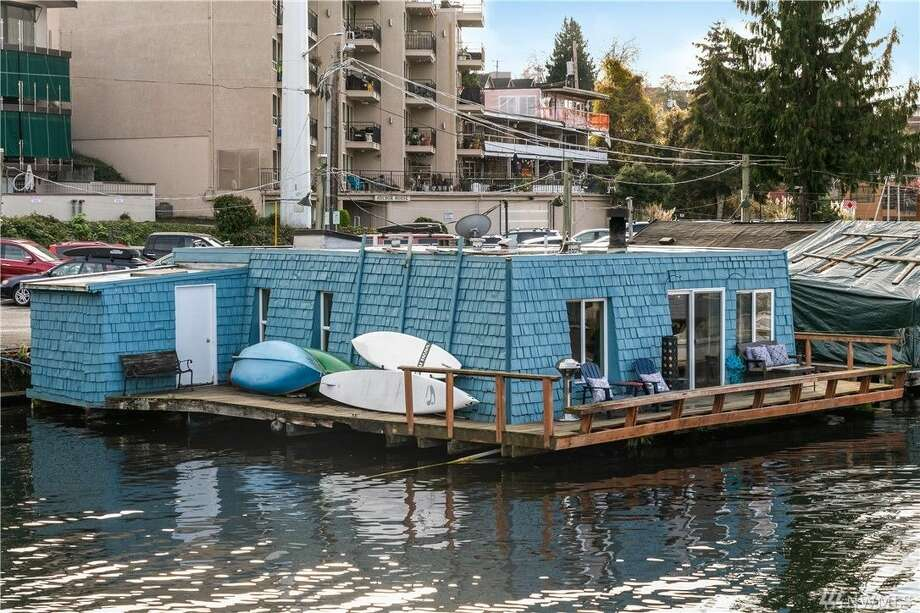 Yours for the first time in 30 plus years, this blue floating home asks $1.03M. Photo: HD Estates