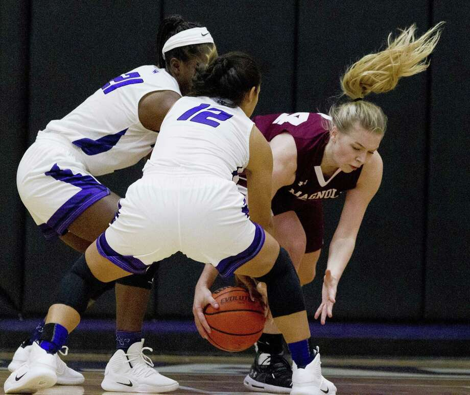 Magnolia forward Sophie Christiansen (34) fights for a loose ball against Willis guard Rayelynn Allison (12) and forward De'Janae Gilmore (21) during the third quarter of a non-district high school girls basketball game at Willis High School, Monday, Nov. 19, 2018, in Willis. Photo: Jason Fochtman, Houston Chronicle / Staff Photographer / © 2018 Houston Chronicle