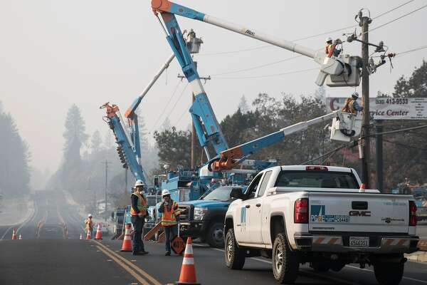 63f4a5048 2of3PG E crews work to clear downed power lines and telephone poles in  Paradise