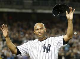 FILE - In this Sept. 26, 2013, file photo, New York Yankees relief pitcher Mariano Rivera acknowledges the crowd's standing ovation after coming off the mound in the ninth inning of his final appearance in a baseball game, at Yankee Stadium in New York. Career saves leader Mariano Rivera and late pitcher Roy Halladay are among 20 new candidates on the Hall of Fame ballot for the Baseball Writers' Association of America, joined by 15 holdovers headed by Edgar Martinez. (AP Photo/Kathy Willens, File)