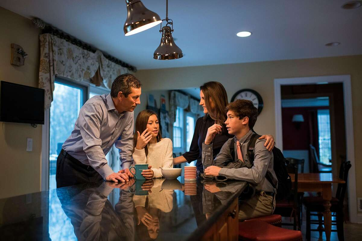David and Jennifer Buckwald with their children Morgan, 12, and Jack, 14, at home in Colts Neck, N.J., on Nov. 16, 2018. Even though they both work in finance -- and hold degrees in psychology -- they didn't know exactly how to approach a conversation about money with their children. (Joshua Bright/The New York Times)