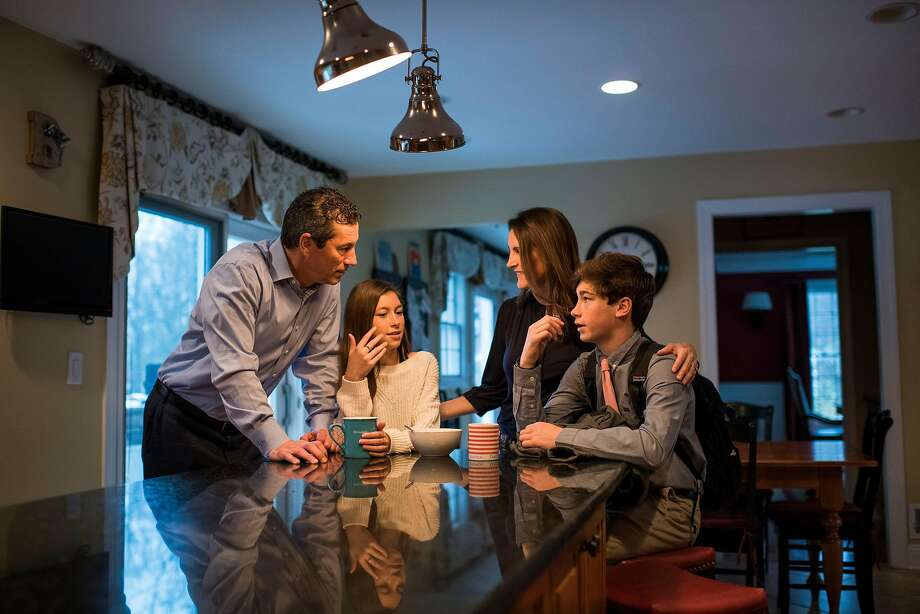 David and Jennifer Buckwald with their children Morgan, 12, and Jack, 14, at home in Colts Neck, N.J., on Nov. 16, 2018. Even though they both work in finance -- and hold degrees in psychology -- they didn't know exactly how to approach a conversation about money with their children. (Joshua Bright/The New York Times) Photo: JOSHUA BRIGHT;Joshua Bright / New York Times