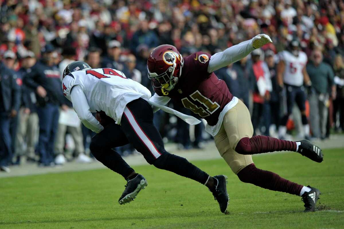 Houston Texans wide receiver DeAndre Carter (left) runs back a punt against Washington Redskins defensive back Danny Johnson (right) during an NFL football game between the Houston Texans and Washington Redskins, Sunday, Nov. 18, 2018, in Landover, Md. (AP Photo/Mark Tenally)