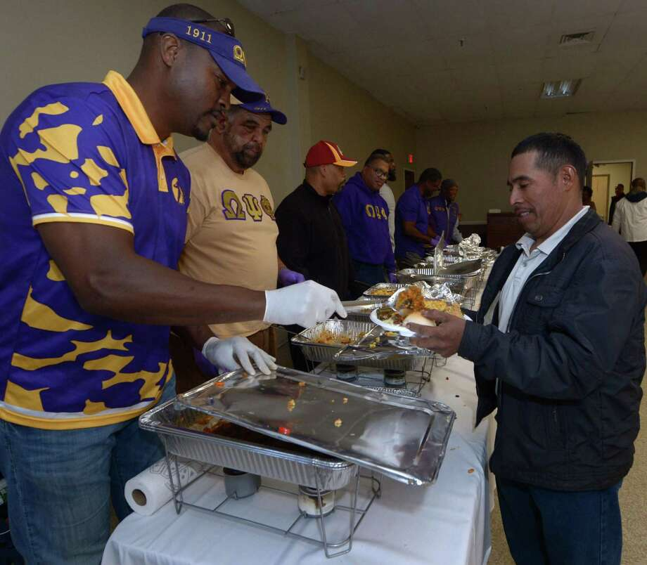 Omega Psi Phi alumni serve food during the South Norwalk Community Association annual Thanksgiving Day meal Thursday, November 23, 2017, at the South Norwalk Community Center in Norwalk, Conn. Photo: Erik Trautmann / Hearst Connecticut Media / Norwalk Hour