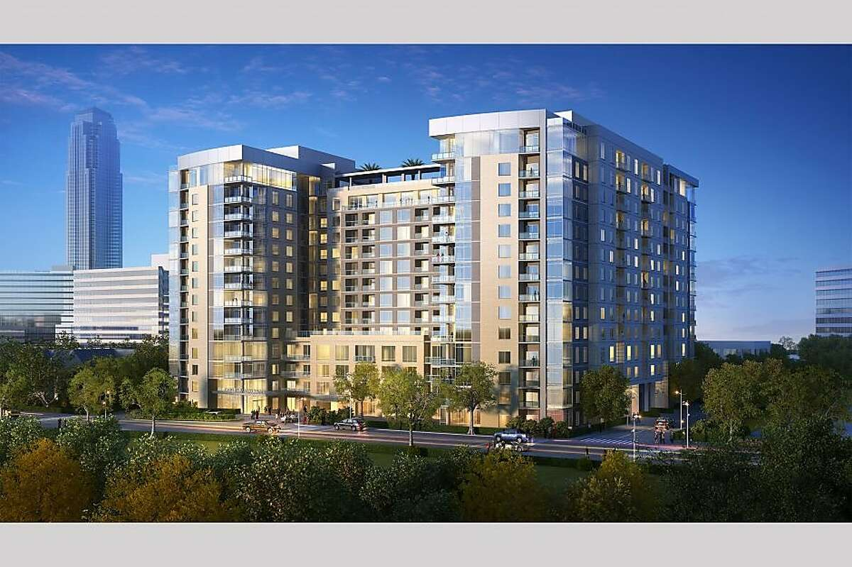 A rendering of a Gables apartment building under construction near the West Loop on Westcreek.