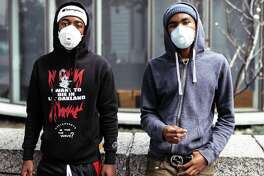 Photographer Pavel Fedorov captured surreal images of San Franciscans wearing protective air masks last Friday and Saturday November 16th and 17th when the air quality index in the city was among the worst in the world.