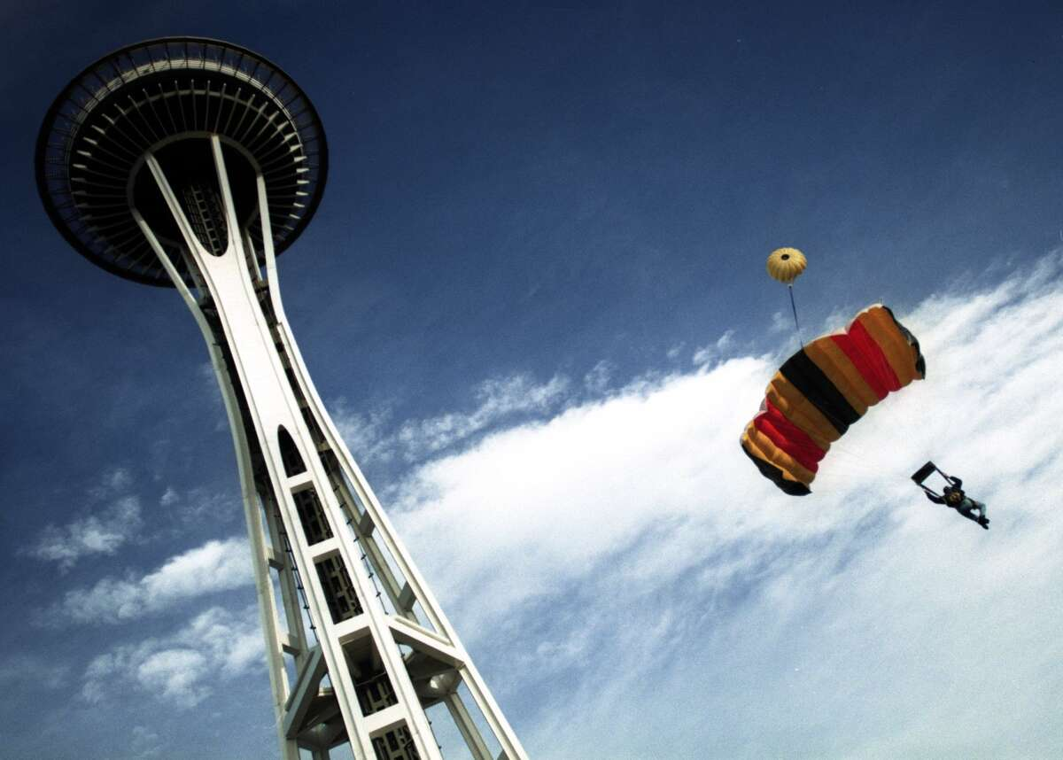 A parachuter jumps off the space needle in the first group of jumpers that leaped aroun 9:40 a.m.