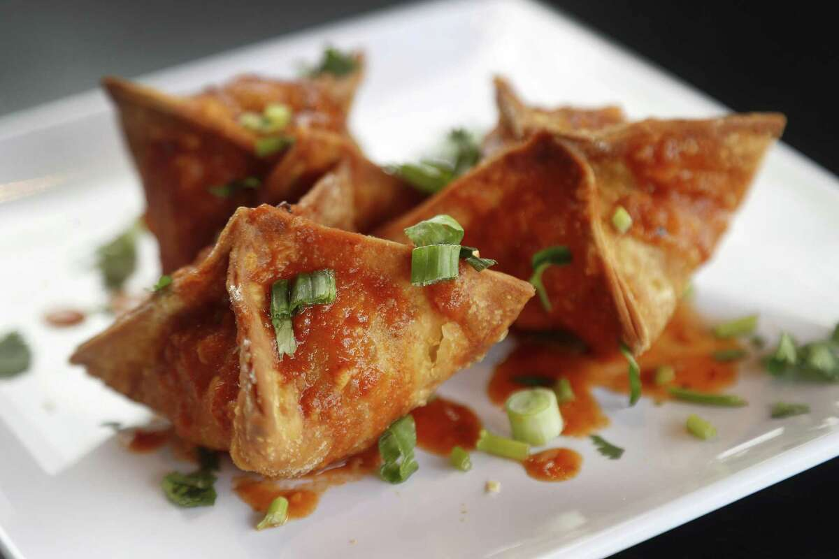 Sing Chili Crab Rangoon with chili sauce at Sing, a new Singaporean-inspired restaurant in the Heights.