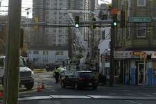 Construction crews work on light poles at the intersection of Henry Street and Atlantic Street in Stamford, Conn. Monday, Nov. 19, 2018. Road improvements under way in Stamford are being affected by the steel and aluminum tariffs President Trump imposed earlier this year. Traffic arms ordered last January as part of an upgrade of the intersection of Henry and Atlantic Streets in the South End now won't arrive for two more months, so traffic engineers will substitute temporary with wooden poles. It will affect six more projects planned for the coming months.