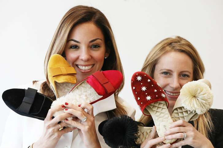 Bianca Gates  (l to r) and Marisa Sharkey, co-founders of Birdies, pose for a portrait with some of their slippers at their Union Street store on Thursday, November 14, 2018 in San Francisco, Calif.