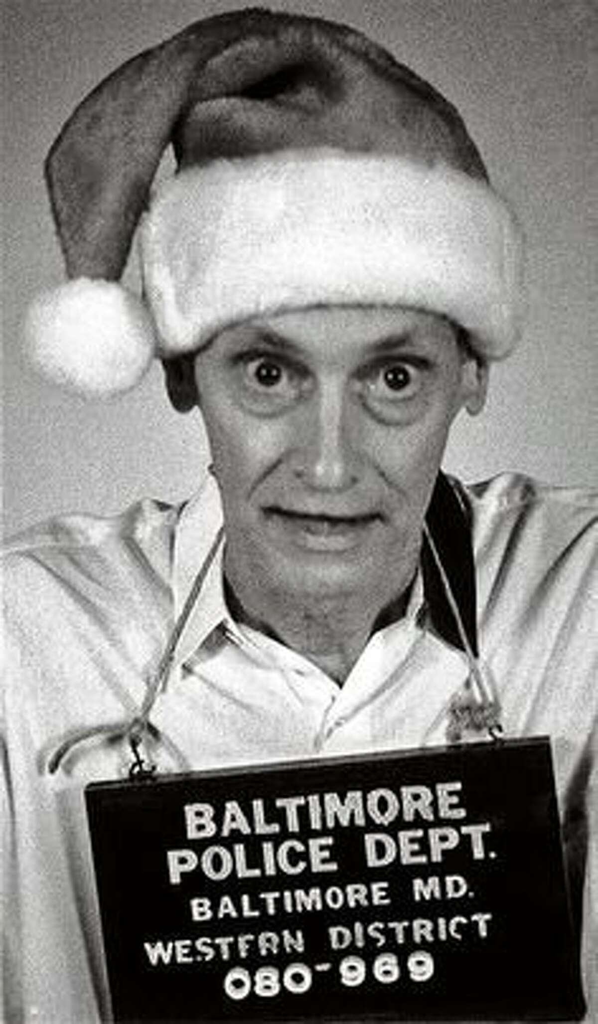 A fake mugshot by the Baltimore Police John Waters used one year as the image for his Christmas card.
