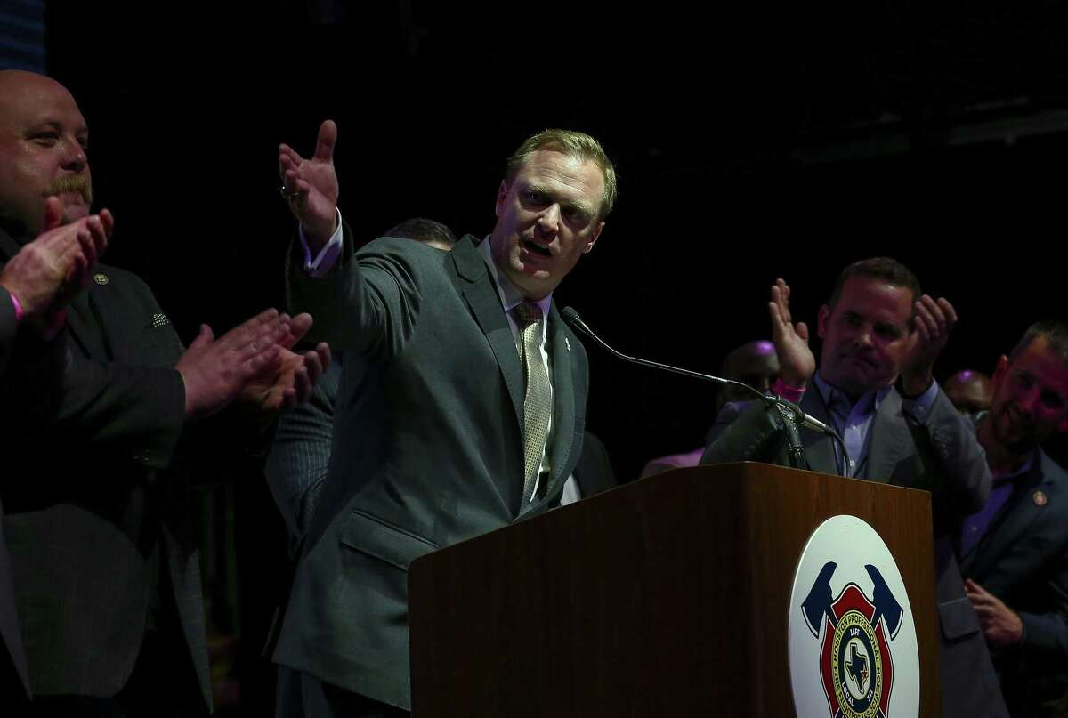 """Houston Professional Fire Fighters Association president Patrick """"Marty"""" Lancton celebrates after Proposition B passed during a watch party at the White Oak Music Hall."""