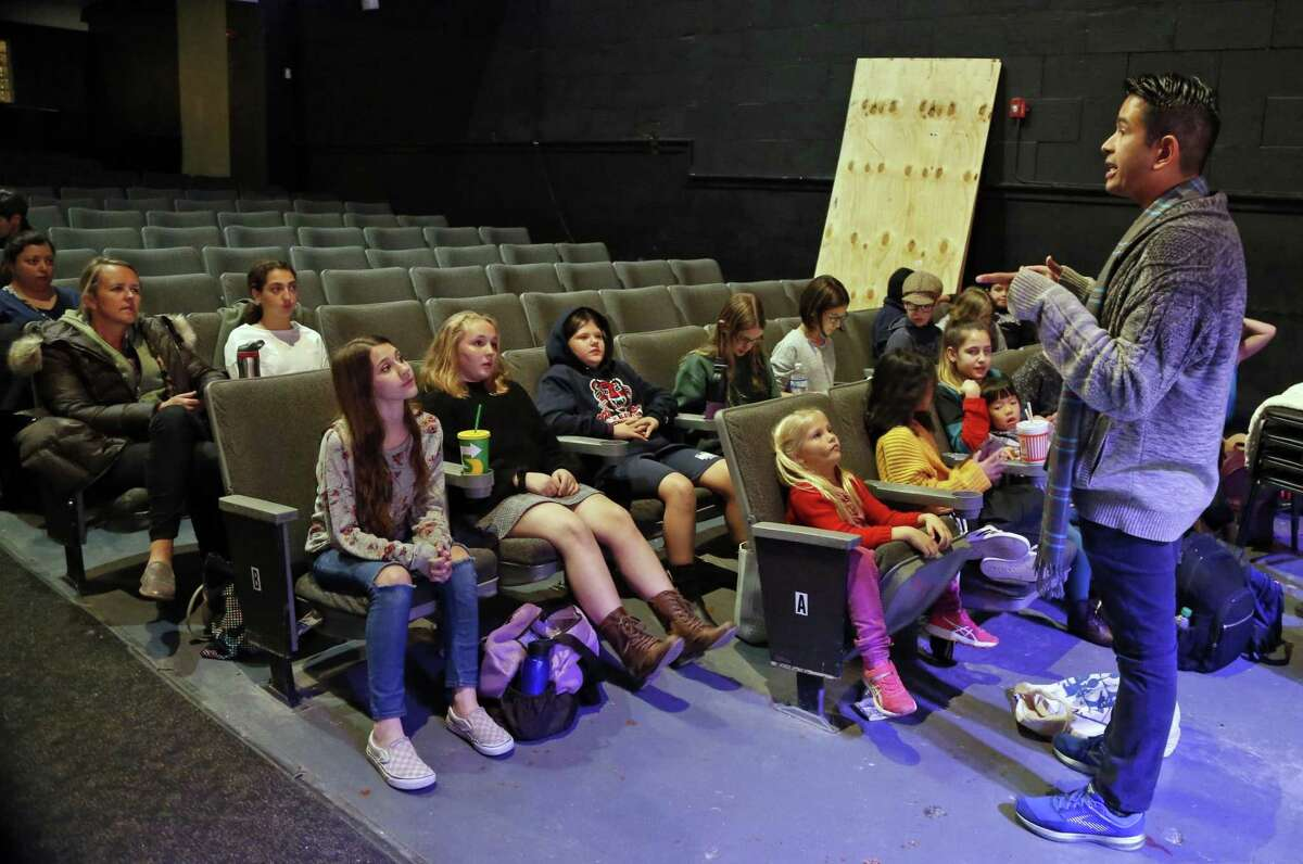 """Christopher Rodriguez, director, instructs the young cast members before a rehearsal for """"Annie"""" at the Woodlawn Theatre."""