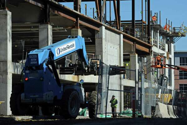 Construction workers with General Growth Properties continue the building of the SoNo Collection mall in Norwalk.