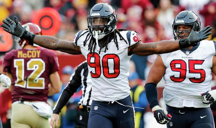 Linebacker Jadeveon Clowney (90) celebrates a sack of Washington's Colt McCoy that helped the Texans hold on for their second consecutive two-point victory on the road that gives them a seven-game winning streak after an 0-3 start.