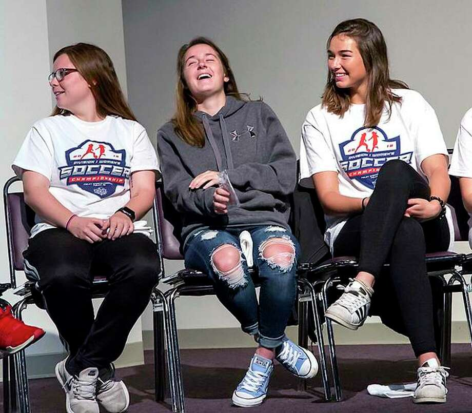 LCCC soccer player Claire Dalton, center laughs during Monday's ceremony honoring the team, which finished 19-1 and advanced to the NJCAA National Tournament. Dalton, a sophomore from Marquette Catholic High, is flanked by teammates Samantha Eckert, left, and Allie Smith. Photo: Jan Dona | For The Telegraph