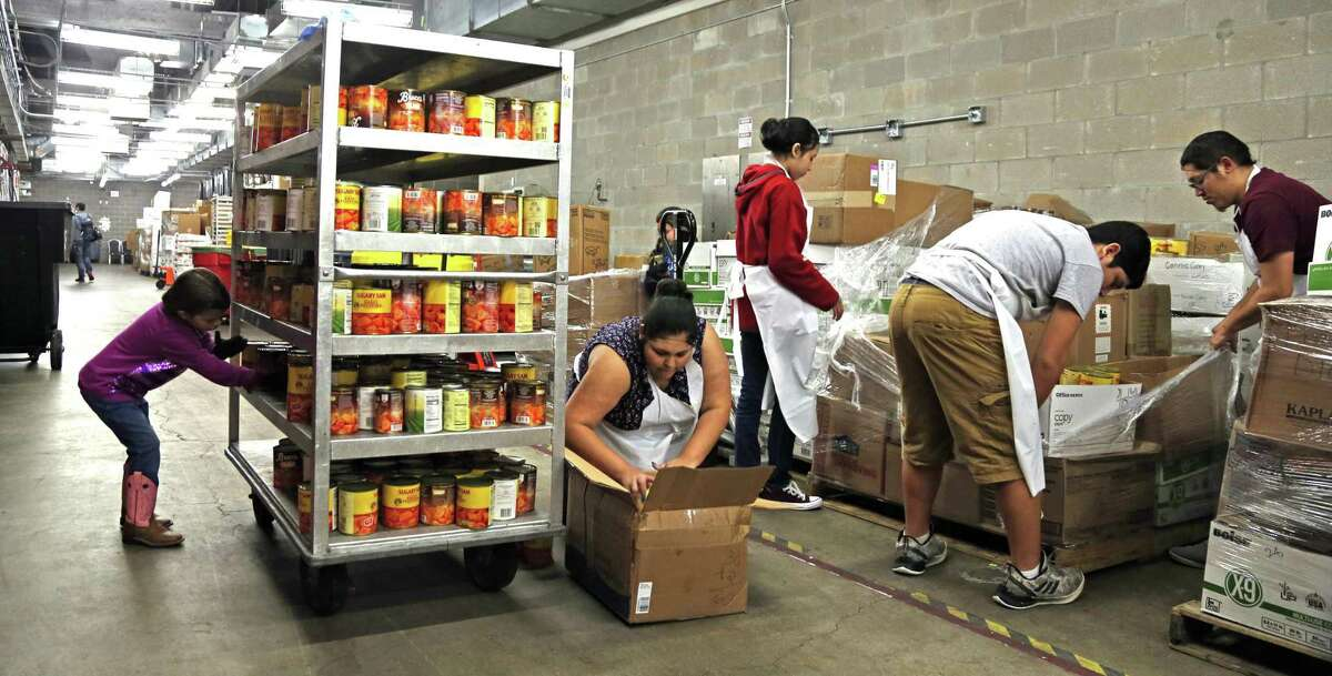 Volunteers assort cans for the Dinner. Jimenez Thanksgiving Dinner prep work. Volunteers are assembling 9,400 pounds of turkey, 6,250 pounds of green beans, 4,688 pounds of yams and more all to feed about 25,000 people on Thanksgiving Day. on Monday , November 19, 2018