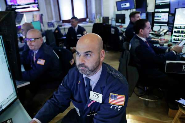 Trader Fred DeMarco follows stock activity, Monday, Nov. 19, 2018, at the New York Stock Exchange. Big technology and internet companies came under heavy selling pressure again on Monday, leading to broad losses across the stock market. The Dow Jones Industrial Average briefly fell 500 points. (AP Photo/Mark Lennihan)