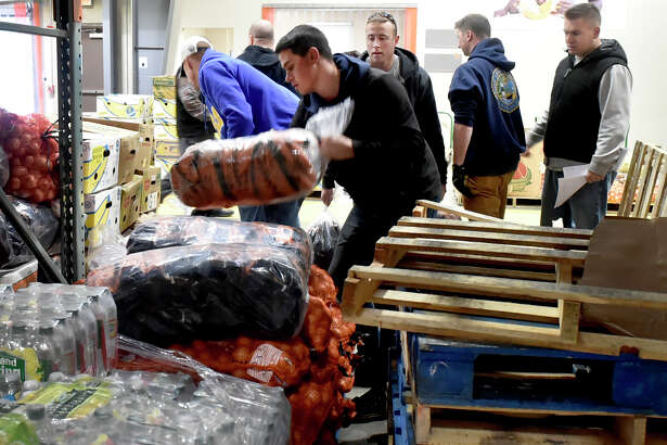 Wallingford, Connecticut - November 19, 2018: 22 U.S. Coast Guard volunteers from Coast Guard Sector Long Island Sound of New Haven help fill community food program Thanksgiving orders and load the food orders in vehicles Monday at the Connecticut food Bank in Wallingford for Connecticut Food Bank member agencies.