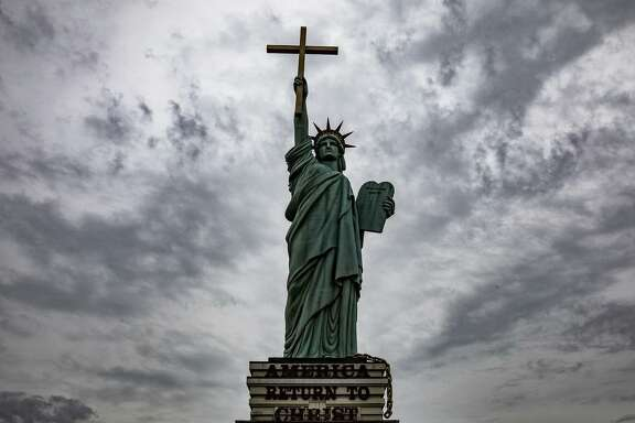 A statue modeled after the Statue of Liberty stands outside the World Overcomers Church in Memphis. Many white Christians have supported President Trump's stance on immigration.