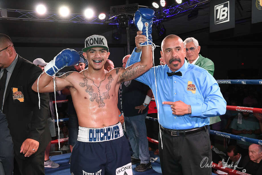 Midland boxer Michael Dutchover celebrates after his second round knockout of Sergio Ramirez in July at the Doubletree Hotel in Ontario, Calif. Photo by Carlos Baeza Photo: Carlos Baeza