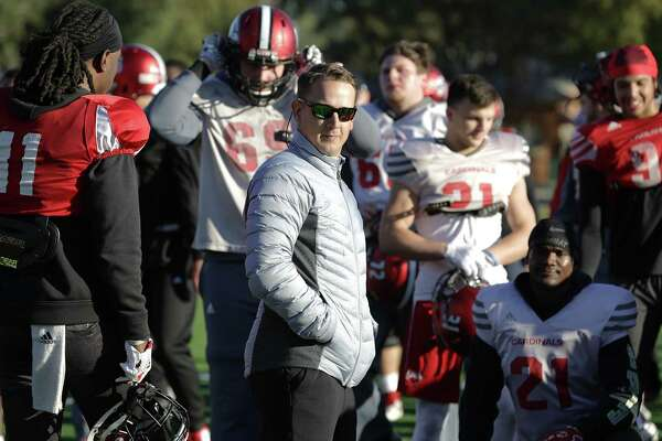 UIW football Head Coach Eric Morris talks to his team as they practice early on Friday, Nov. 16, 2018, preparing for a possible invitation to the NCAA playoffs.