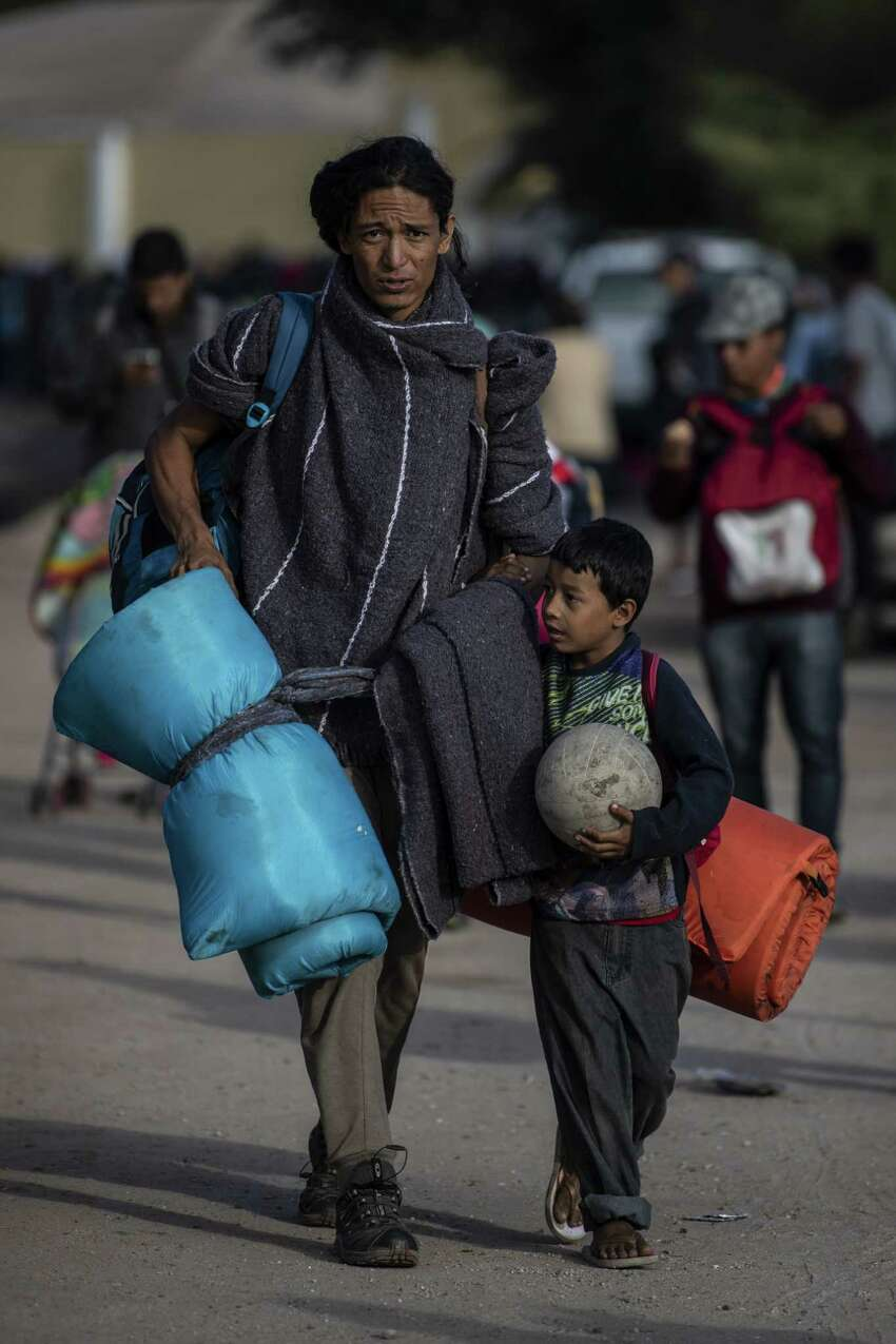 A Central American migrant, heading in caravan towards the United States, is pictured a shelter, in Mexicali, Baja California state, Mexico, on November 18, 2018. - The Central American migrant caravan faced a desperate situation Friday as its numbers swelled at the US-Mexican border, where it got a cold welcome and a warning that its chances of entering the United States were