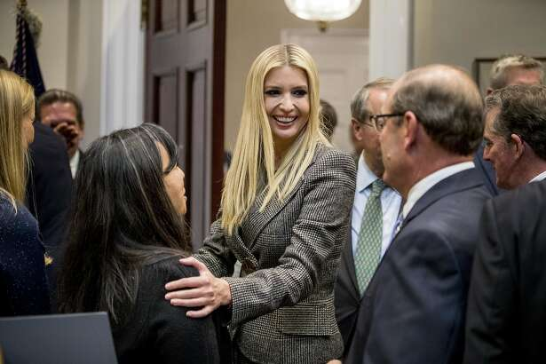 In this Nov. 14, 2018, photo, Ivanka Trump, the daughter of President Donald Trump, center, greets guests after President Donald Trump spoke about prison reform in the Roosevelt Room of the White House in Washington. Ivanka Trump, the president's daughter and adviser, sent hundreds of emails about government business from a personal email account last year. That's according to the Washington Post, which reports the emails were sent to other White House aides, Cabinet officials and her assistants. (AP Photo/Andrew Harnik)