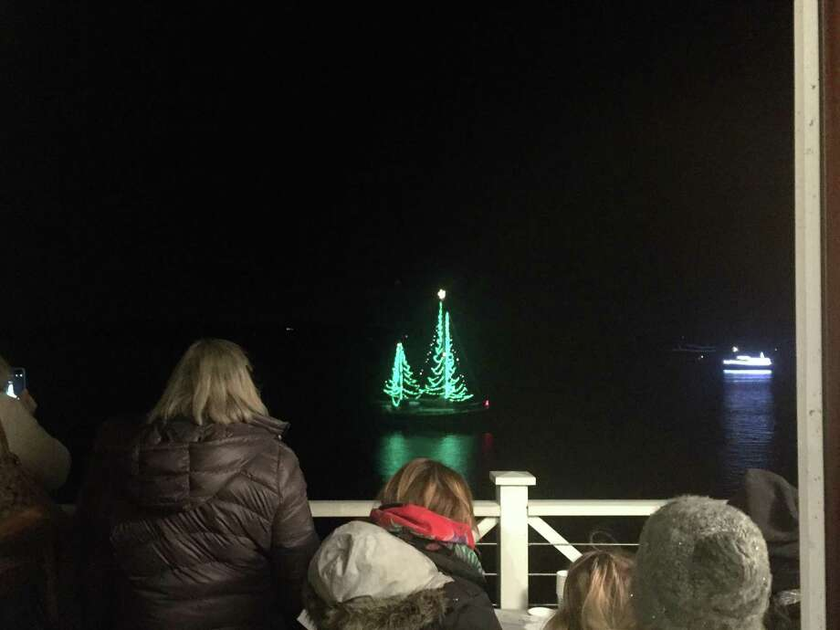 Essex is hosting the annual Trees in the Rigging Community Carol Sing and Lighted Boat Parade, Nov. 25. The Connecticut River Museum, the Essex Board of Trade, and the Essex Historical Society combine to present this annual event. Above, judges view the boat competition. Photo: Contributed Photo /