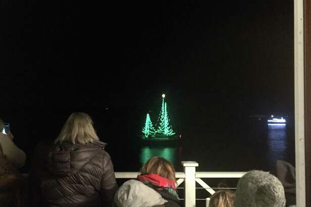 Essex is hosting the annual Trees in the Rigging Community Carol Sing and Lighted Boat Parade, Nov. 25. The Connecticut River Museum, the Essex Board of Trade, and the Essex Historical Society combine to present this annual event. Above, judges view the boat competition.
