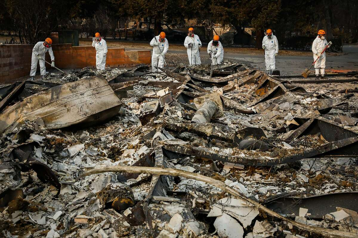 Search and Rescue crews from Oregon look for remains off of Edgewood Lane after the Camp Fire destroyed the town of Paradise, California, on Monday, Nov. 19, 2018.