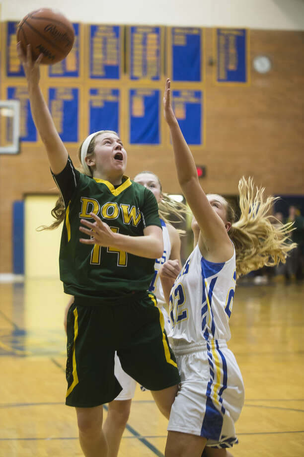 Dow High's Molly Davis goes hard to the basket in a Dec. 19, 2017 game against Midland High. Photo: Daily News File Photo