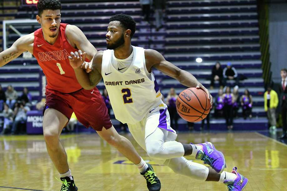 University at Albany's Ahmad Clark is guarded by Oneonta's Jacob Rodriguez as he drives to the hoop during a basketball game at SEFCU Arena on Monday, Nov. 19, 2018 in Albany, N.Y. (Lori Van Buren/Times Union) Photo: Lori Van Buren / 20045116A