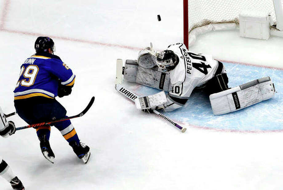 Los Angeles Kings goaltender Calvin Petersen (40) deflects a shot from the Blues' Vince Dunn (29) Monday night in St. Louis. Photo: AP Photo